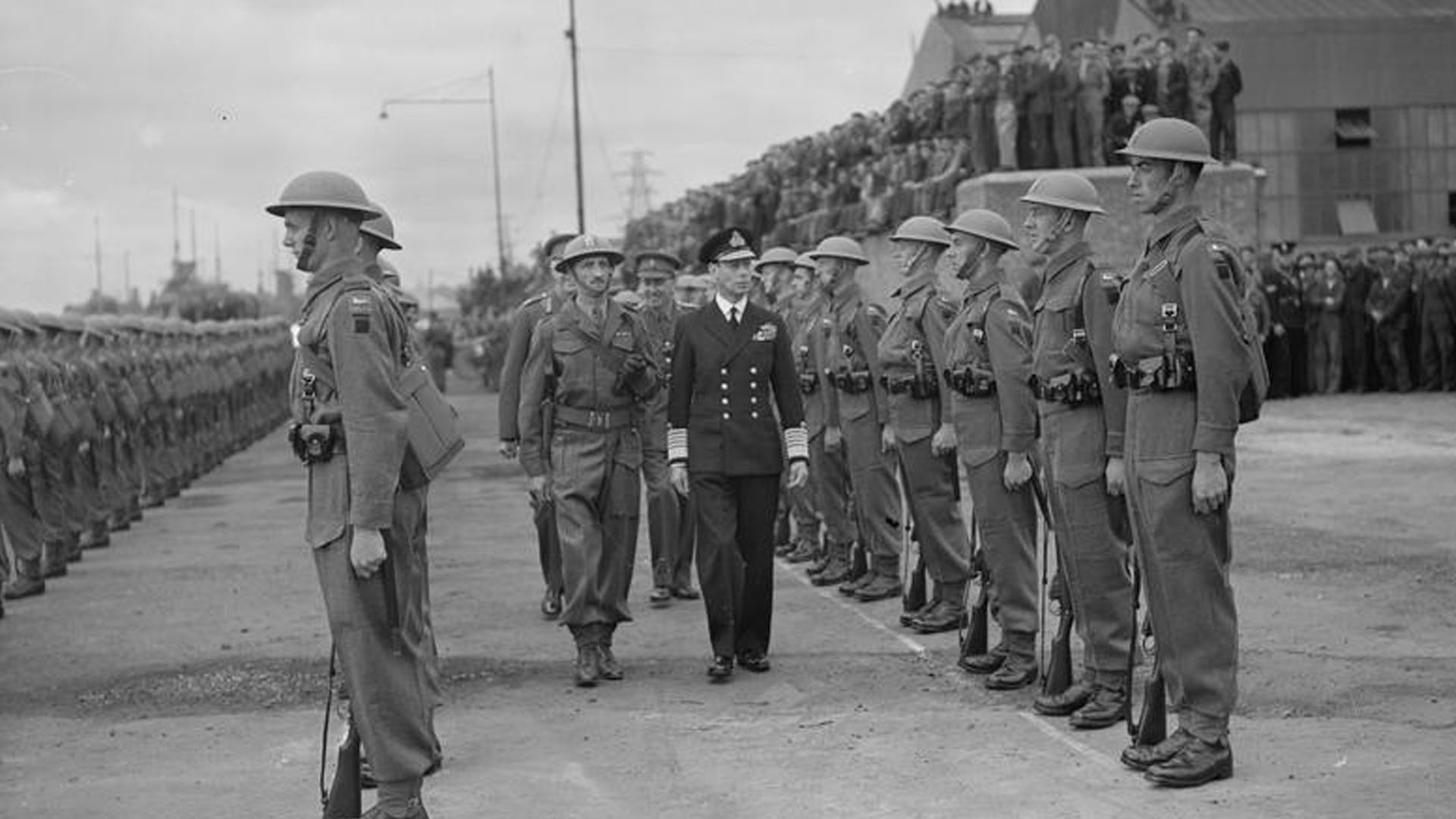 King George VI inspects the guard of honour at HMS Phoebe
