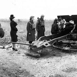Munitions workers fire guns at a camp at Downpatrick, Co. Down